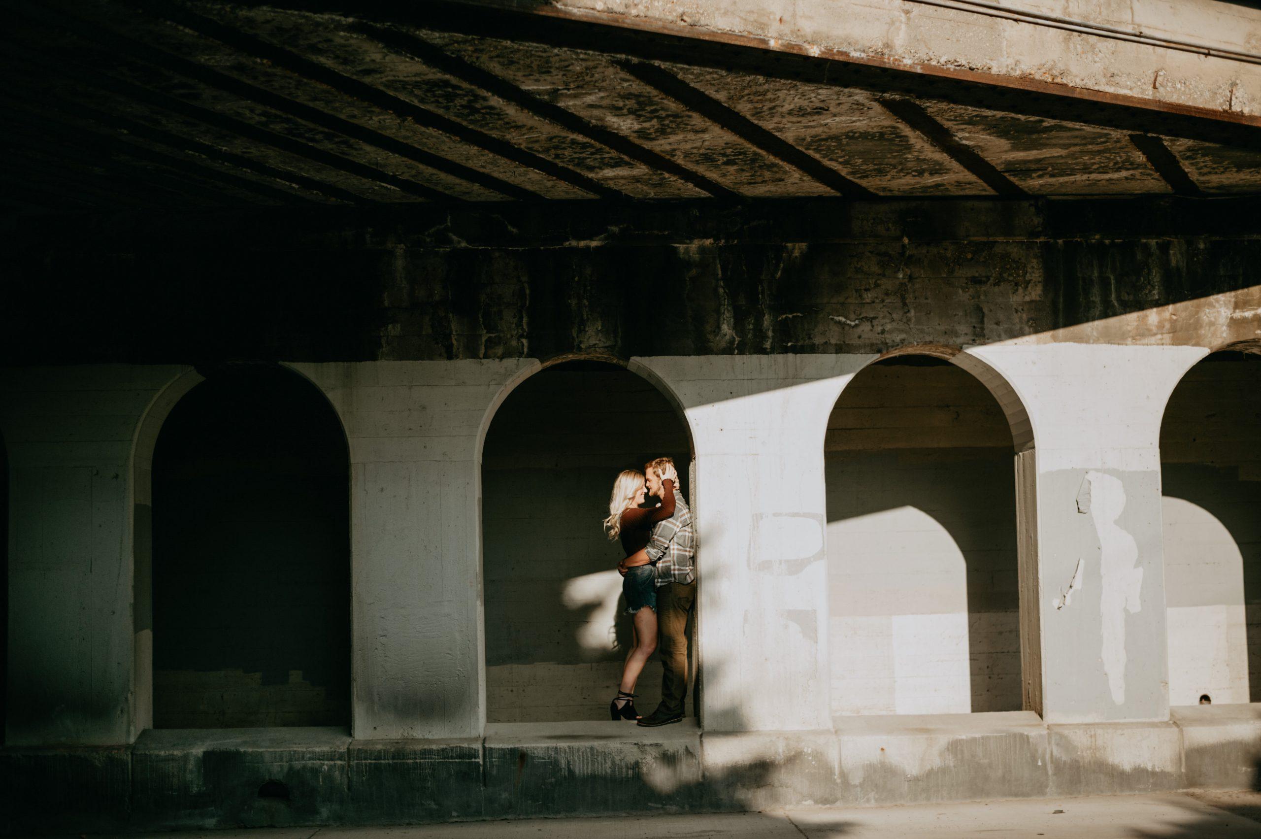 downtown minneapolis direct sunlight bridge underpass engagement photos minneapolis