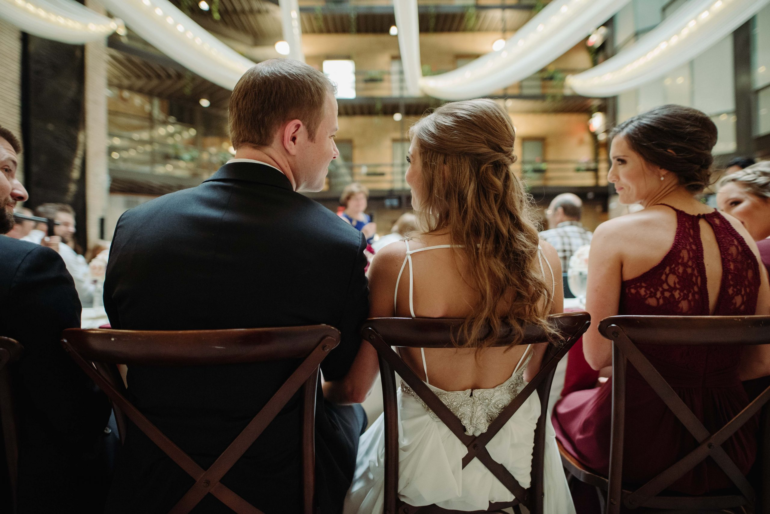 Bride and groom at head table during wedding reception Lumber Exchange Minneapolis