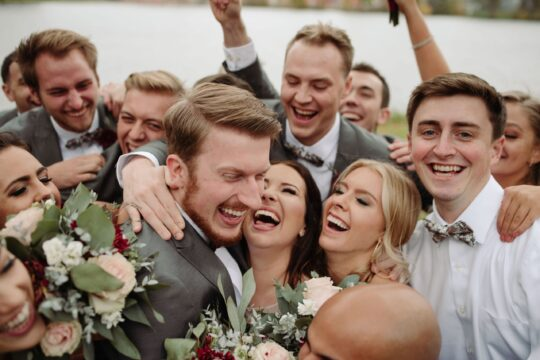 bride and groom with wedding party rochester minnesota