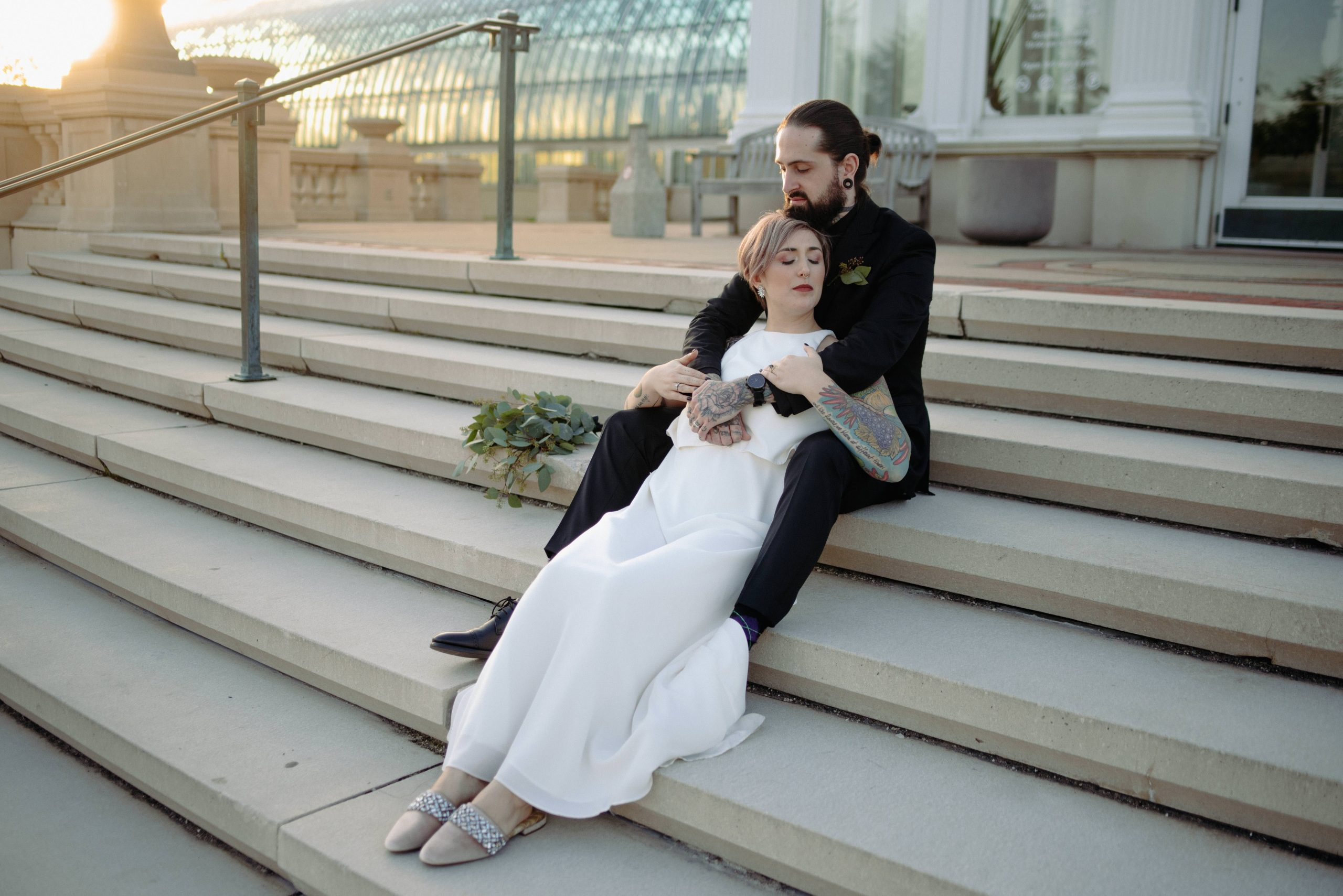 bride and groom on steps during sunset como zoo conservatory st paul minnesota