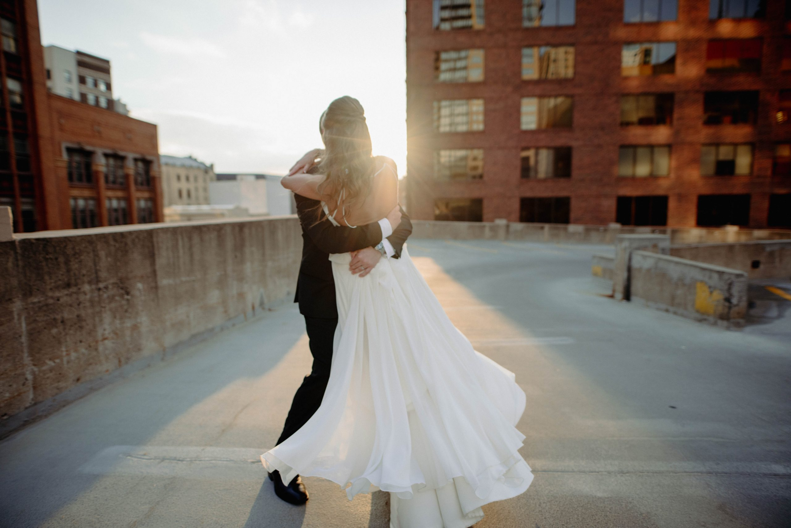 Bride and groom on rooftop during sunset Lumber Exchange Minneapolis