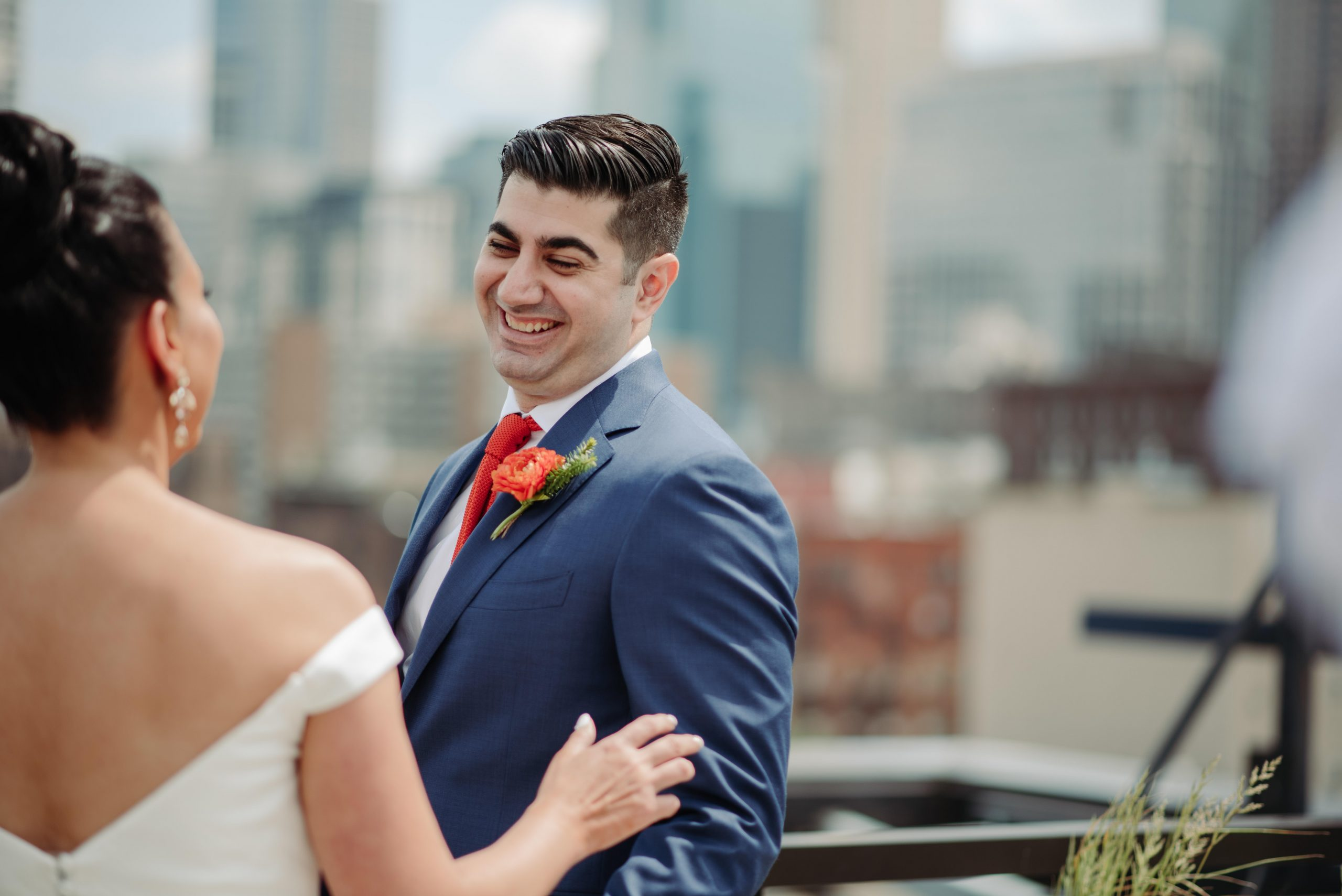 groom first look on a rooftop hewing hotel minneapolis