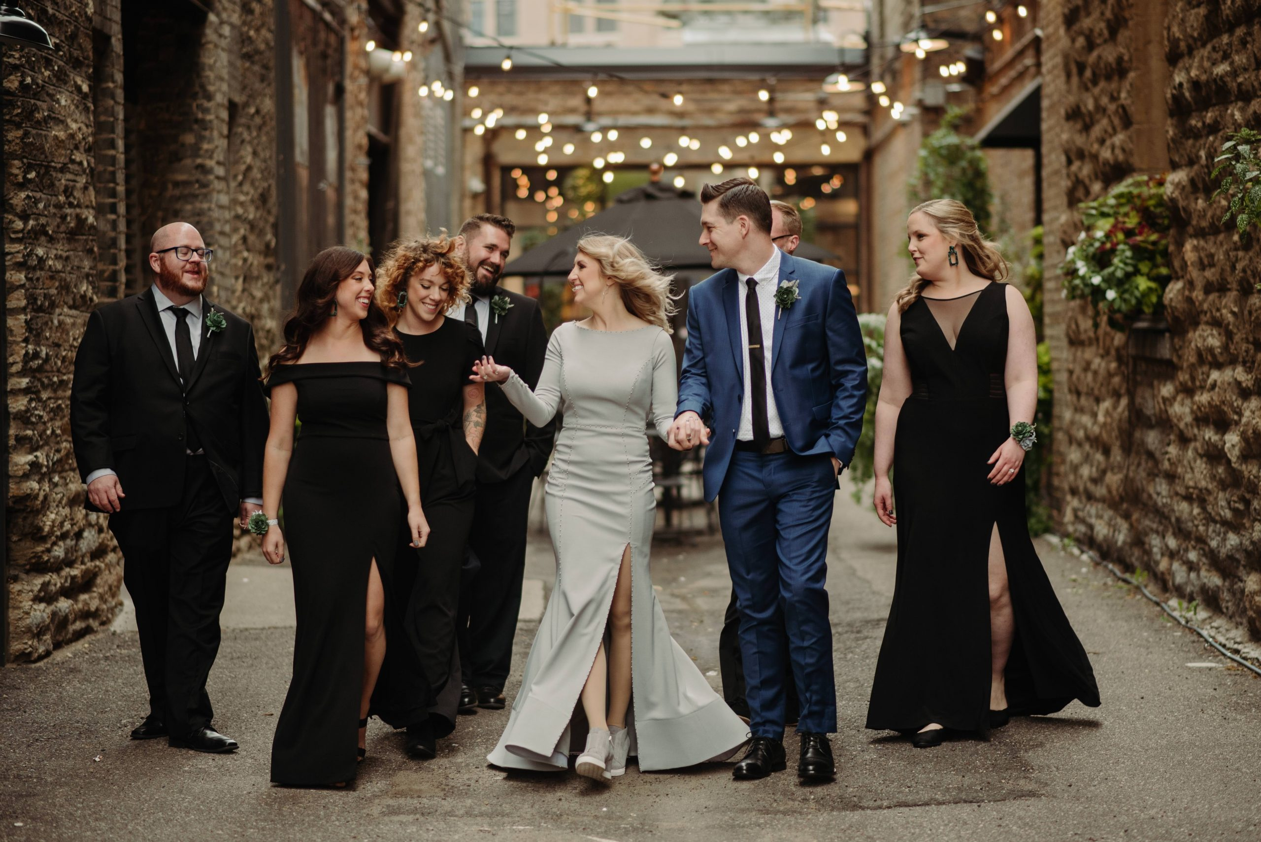 wedding party walking down alleyway hewing hotel minneapolis minnesota