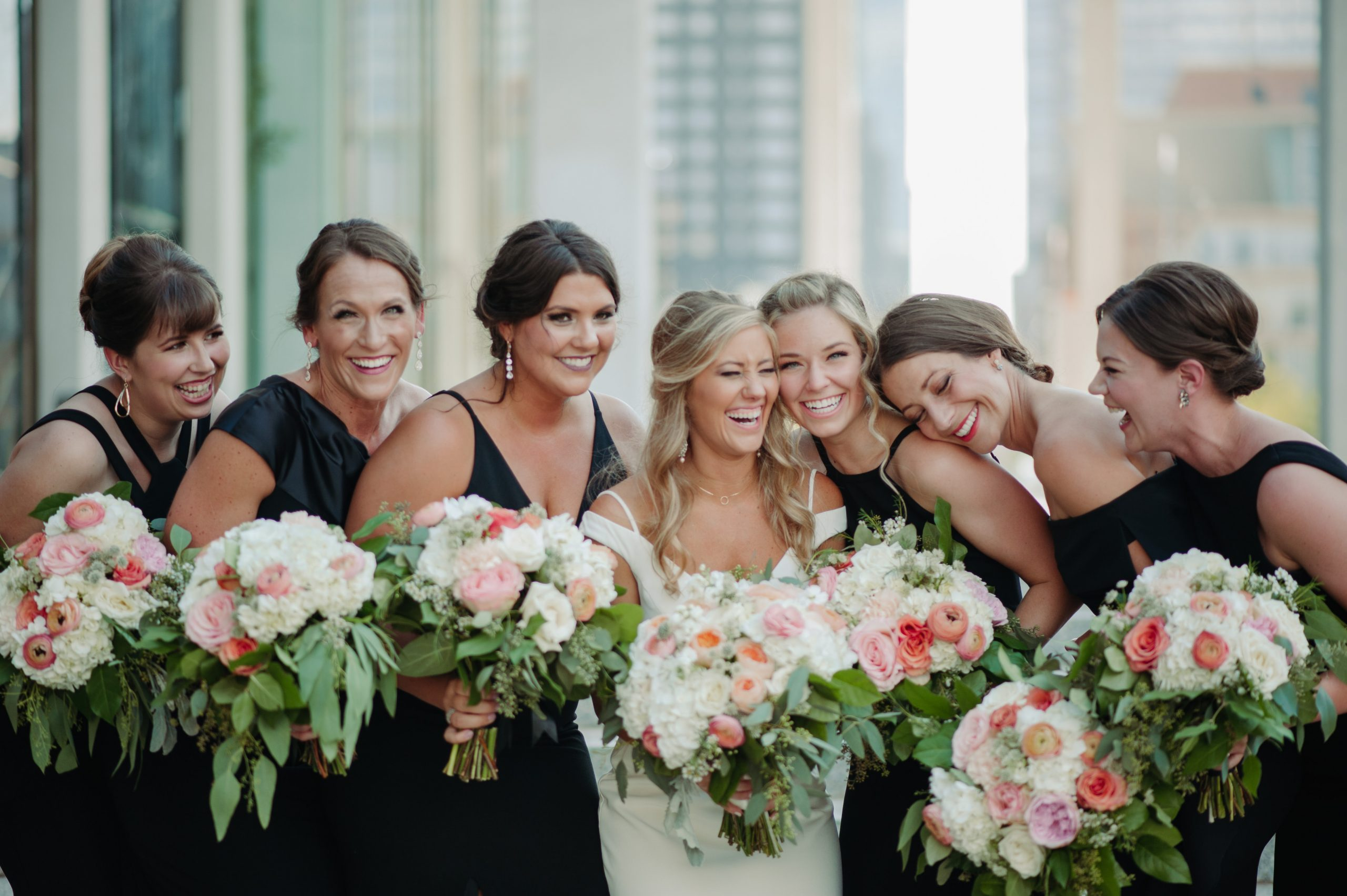 bridesmaids laughing minneapolis minnesota wedding with bouquets