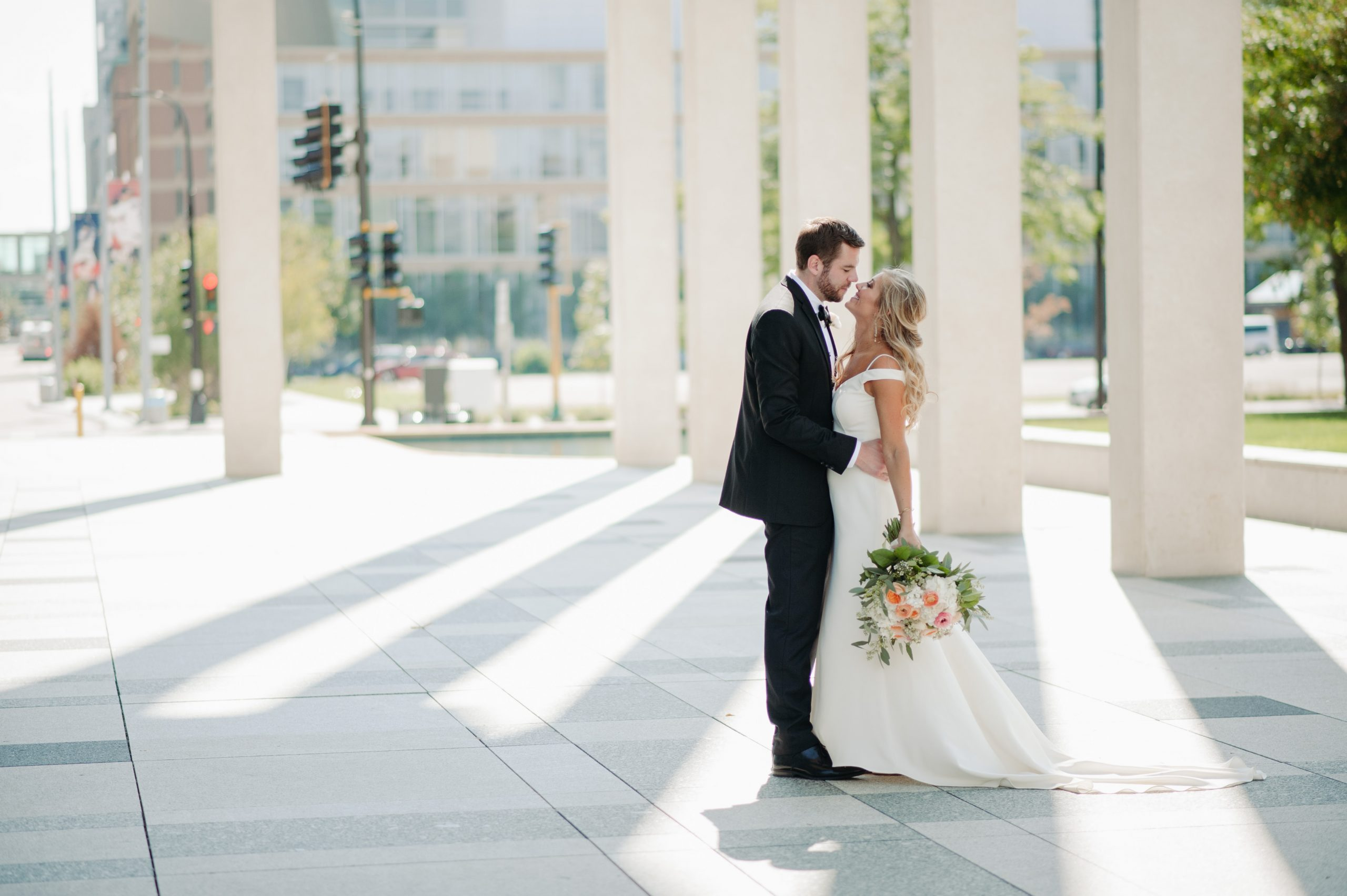 bride and groom in downtown sunset minneapolis minnesota wedding