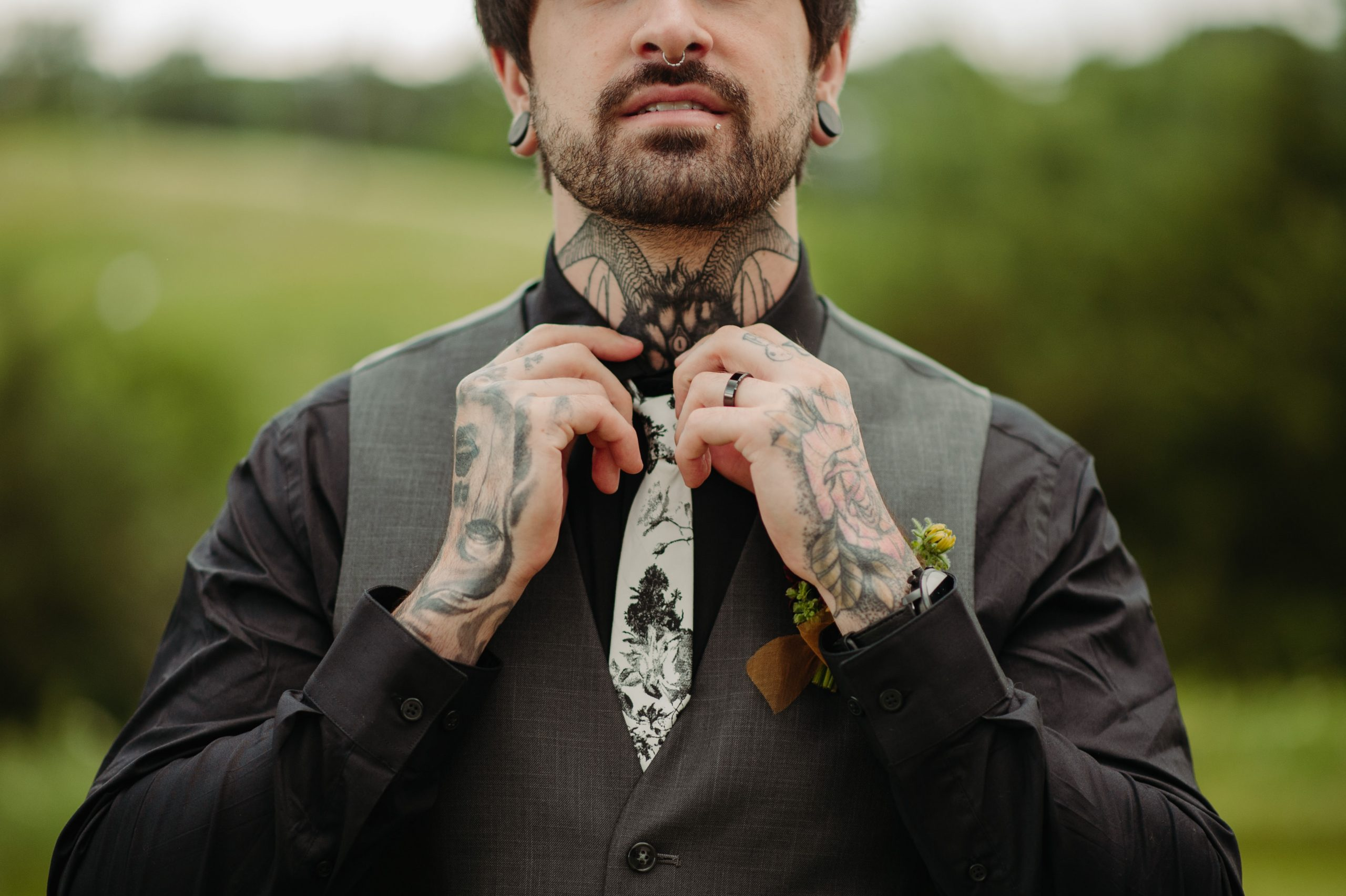 groom with tattoos fixing tie minneapolis minnesota