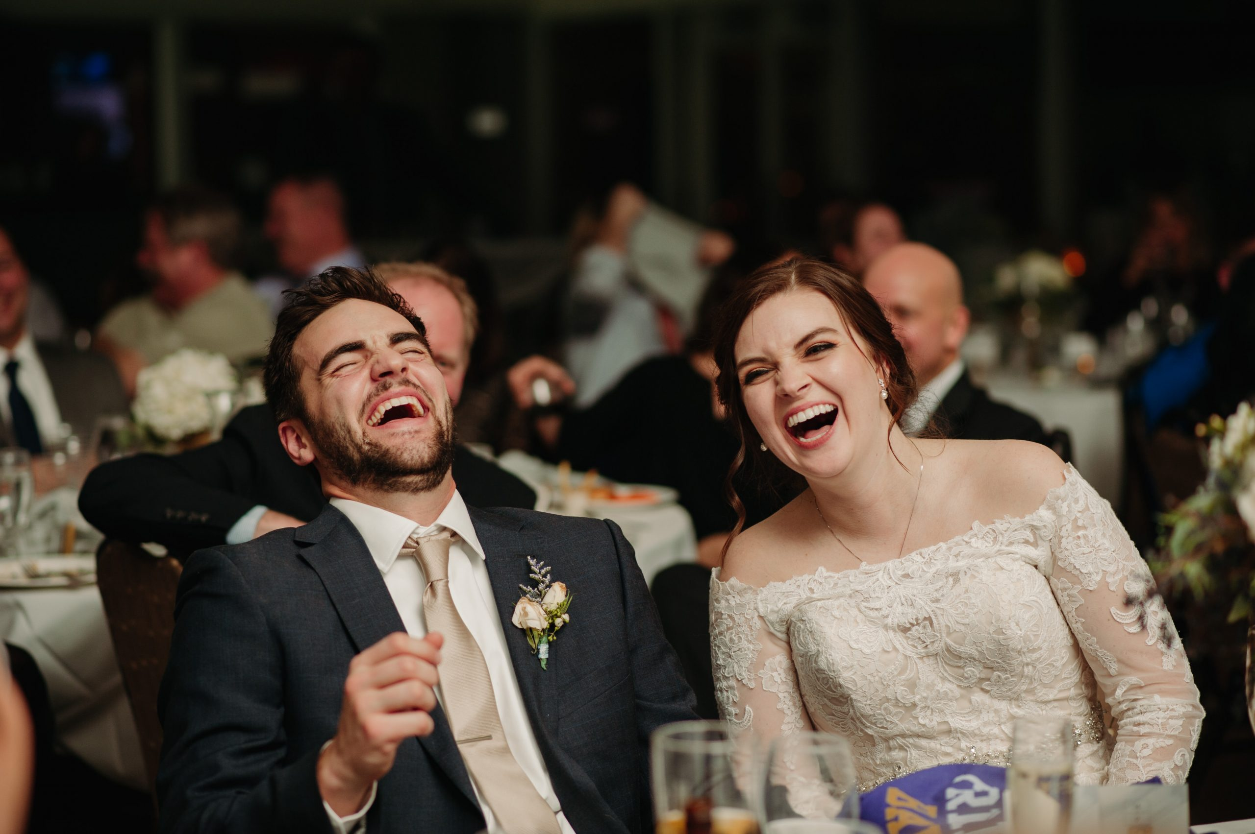 bride and groom laughing during toasts royal golf club wedding