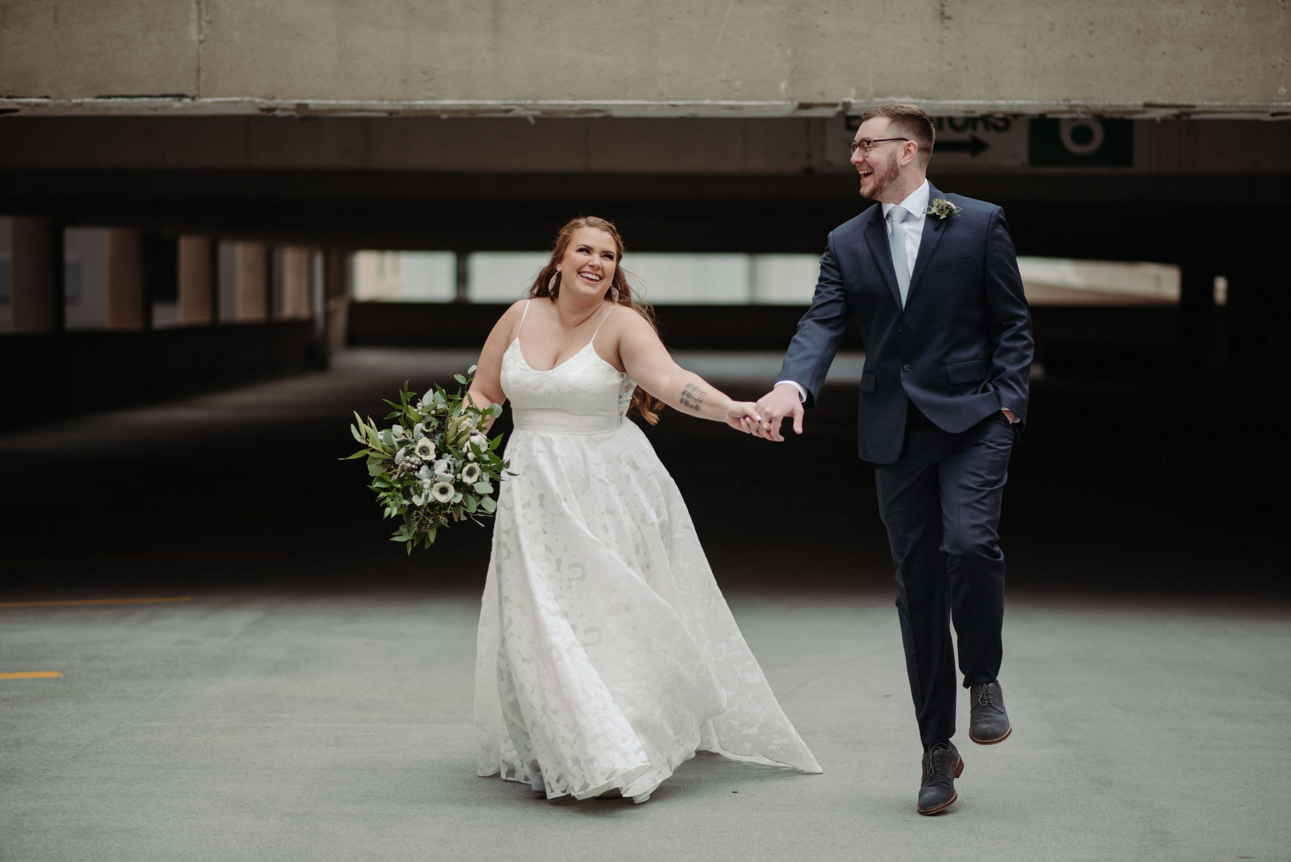 bride and groom on parking garage rooftop minneapolis minnesota lumber exchange wedding