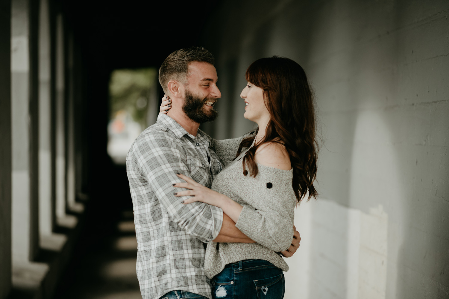 engaged couple smiling laughing