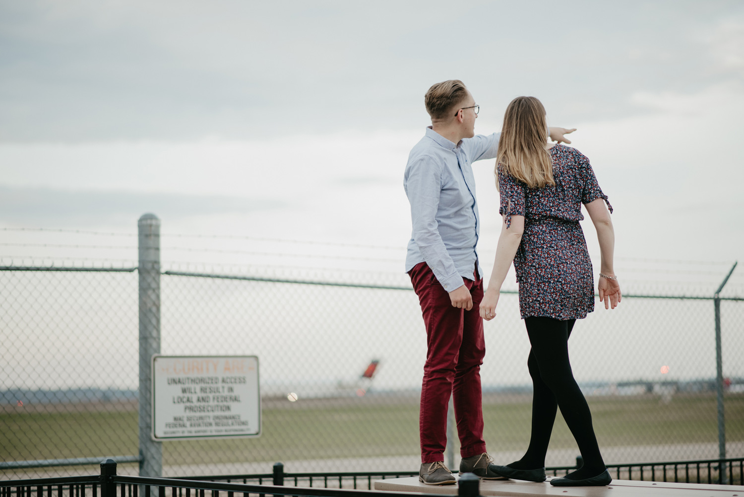 engaged couple looking at plane