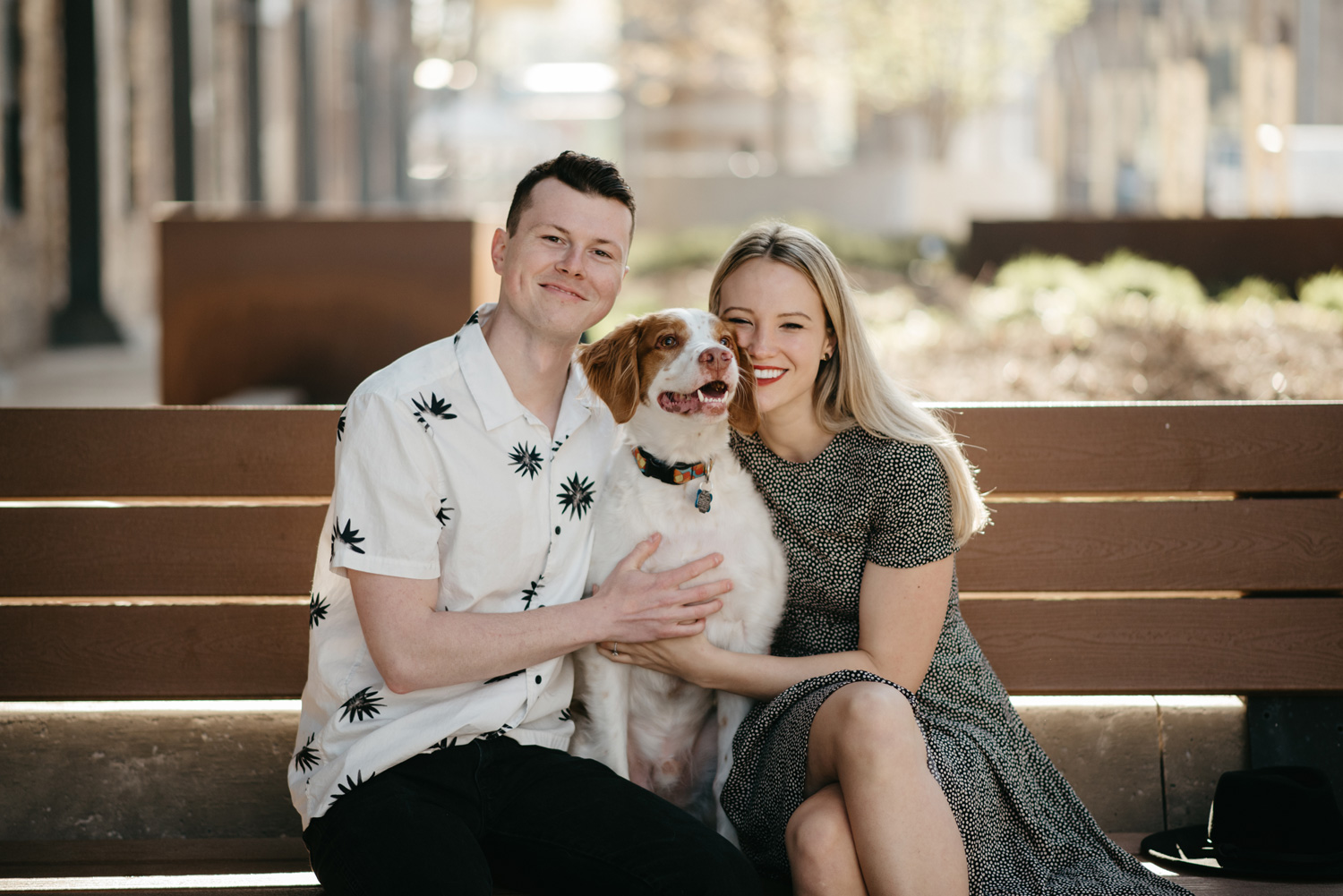 engaged happy couple posing with dog