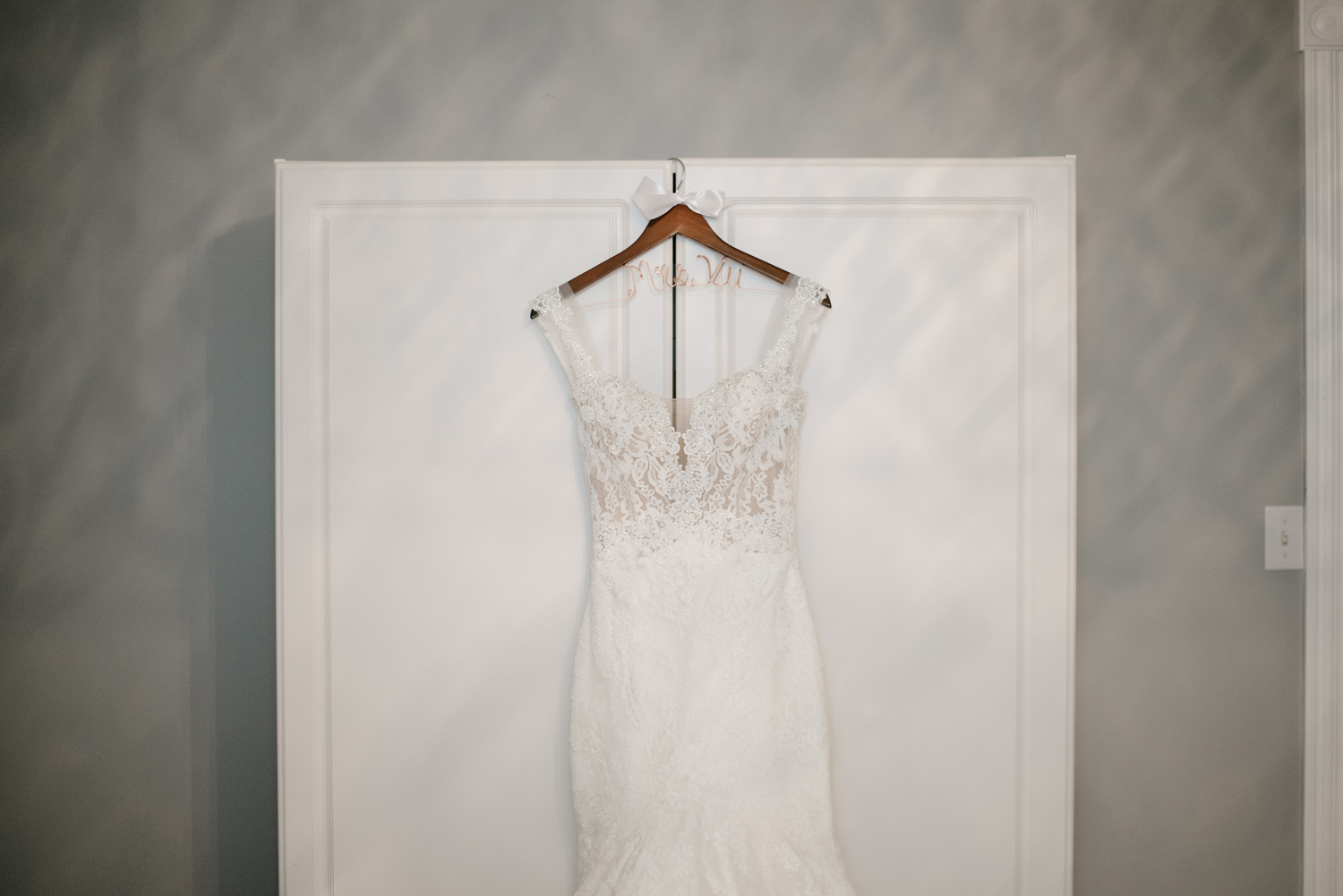wedding dress hanging on a wardrobe