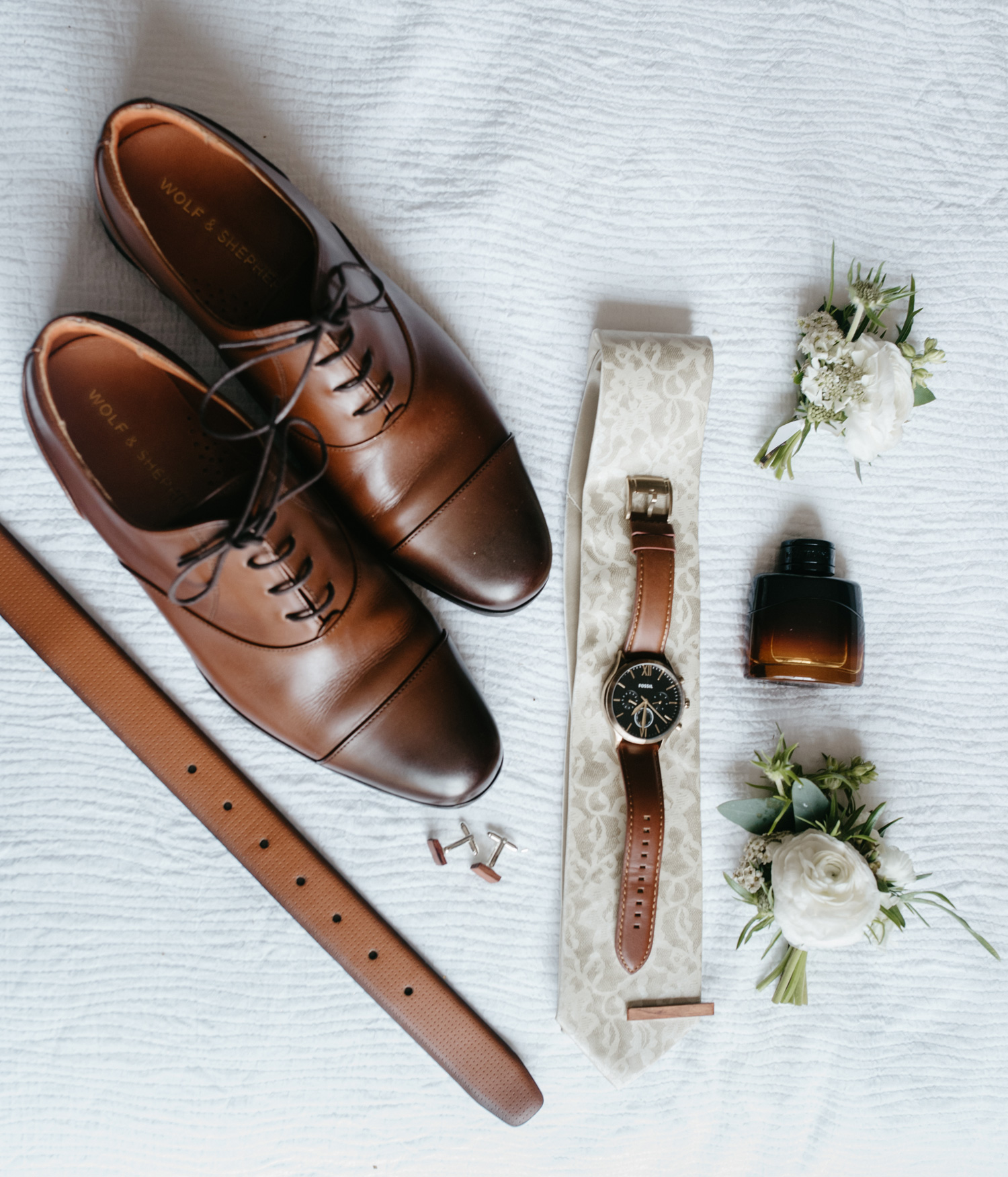 groom's wedding day details including shoes watch tie tie clip cufflinks belt and cologne