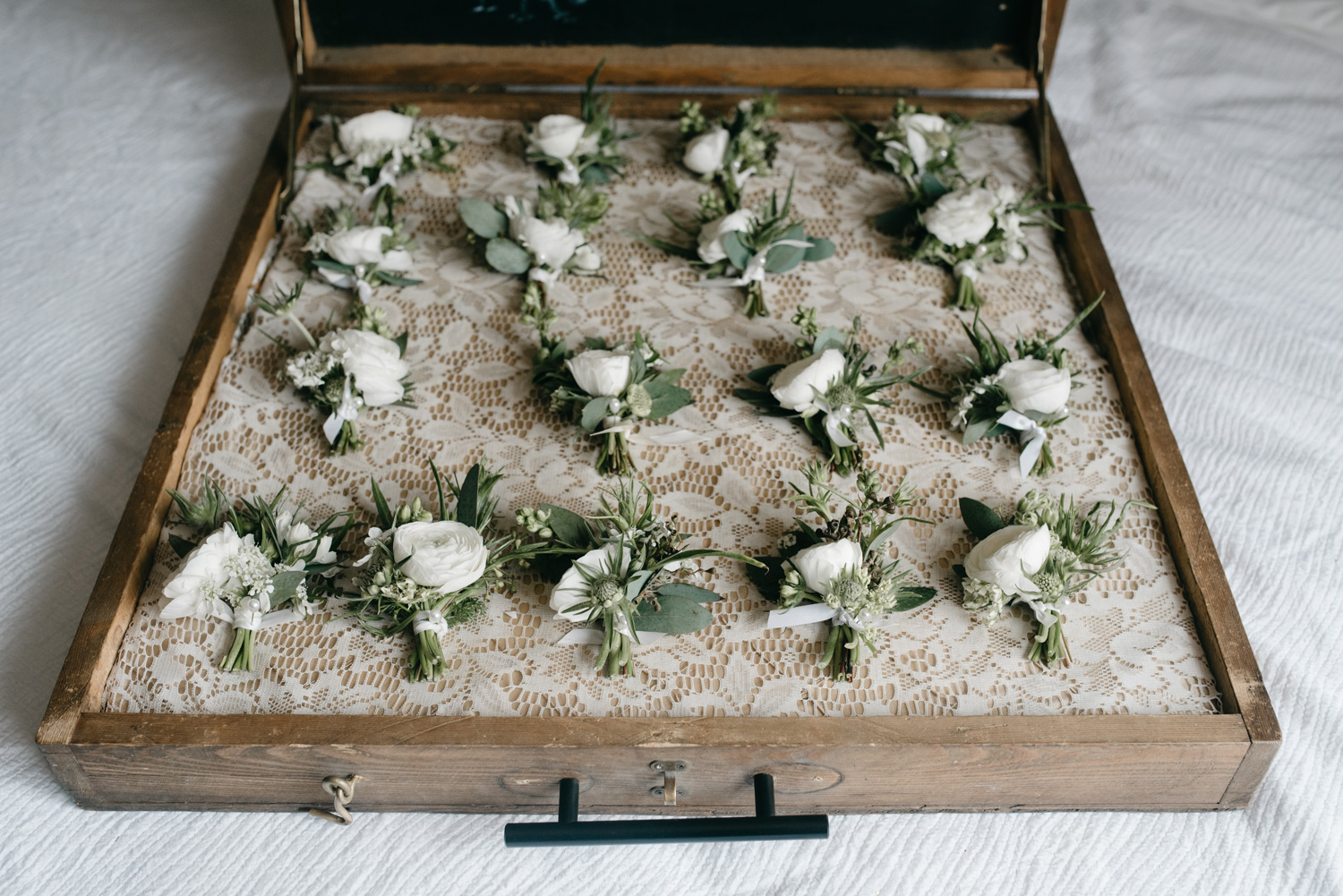 Box of bouttonieres wedding