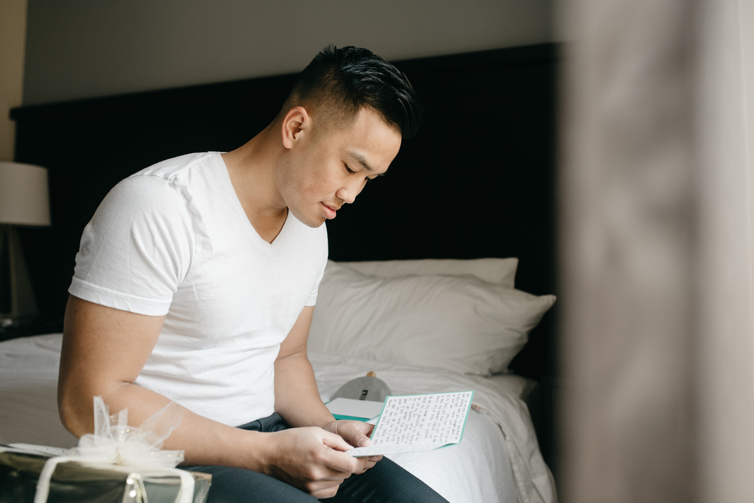 groom reading letter on wedding day