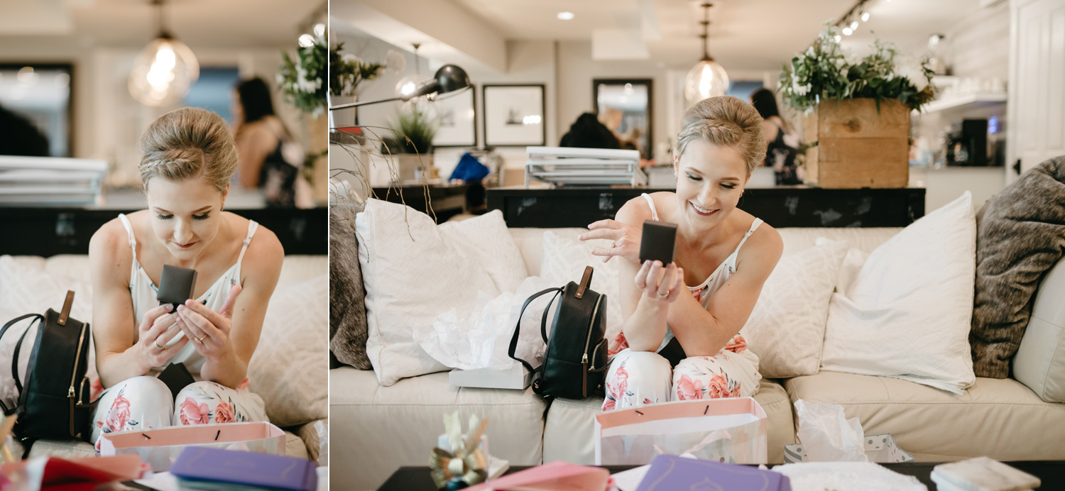 Bride opening gifts on wedding day