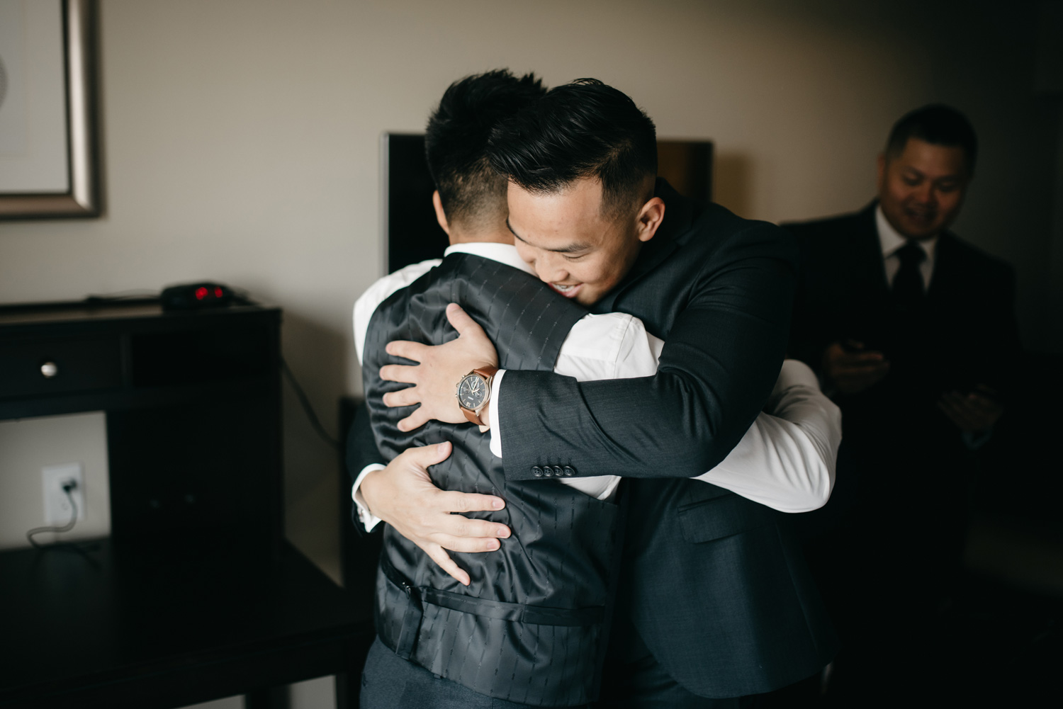 Best man hugging groom