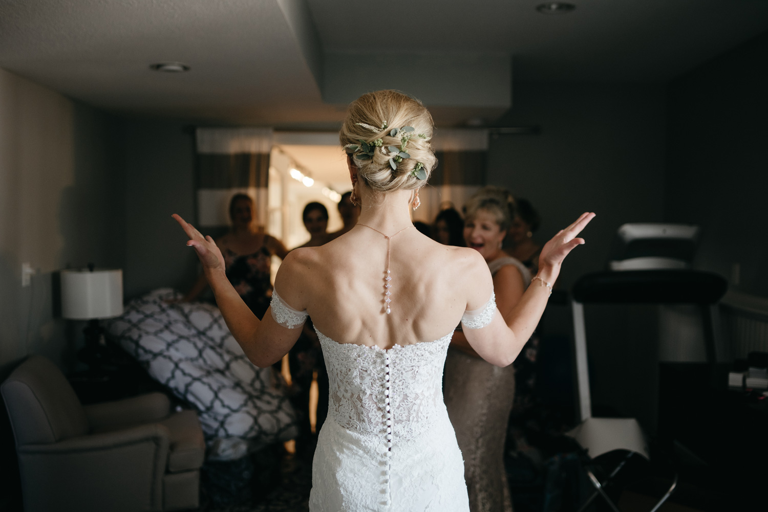 Bride showing off her dress from behind