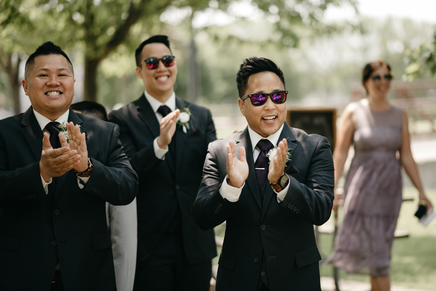 Groomsmen clapping with sunglasses on