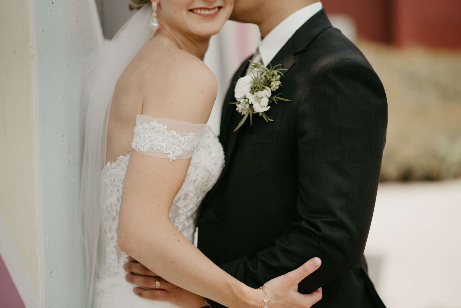 Close up image of bride and groom cuddling