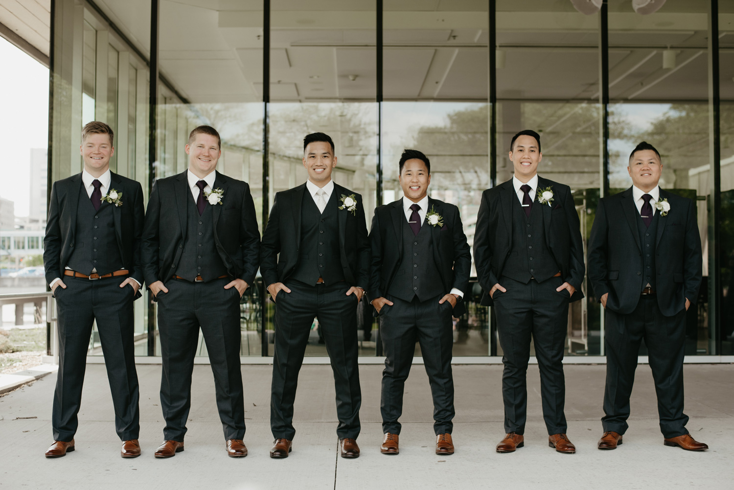 Groom standing with groomsmen for portrait
