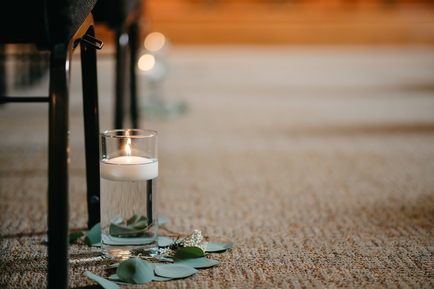 Ceremony aisle decor candle and eucalyptus