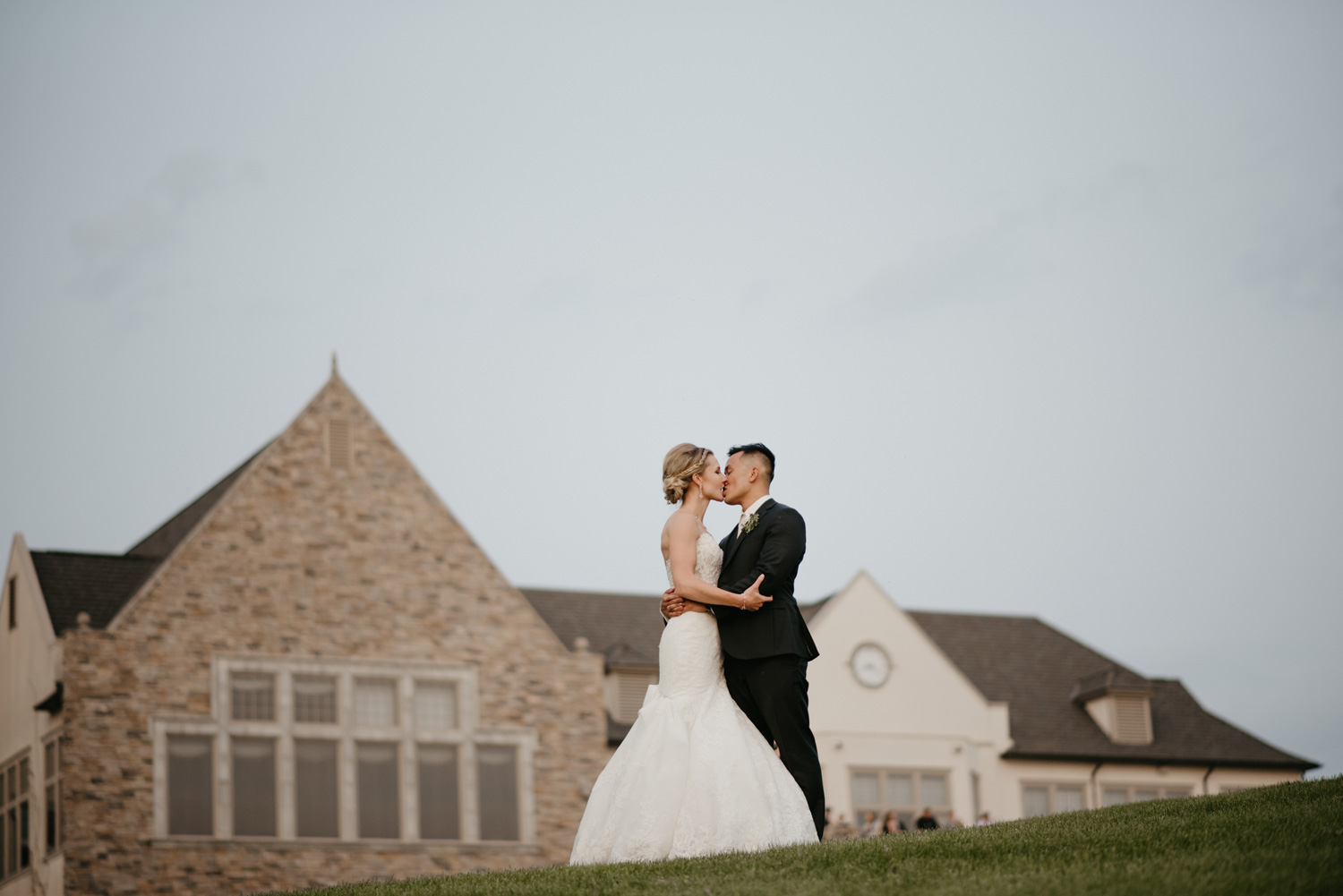 Sunset photos on golf course bride and groom