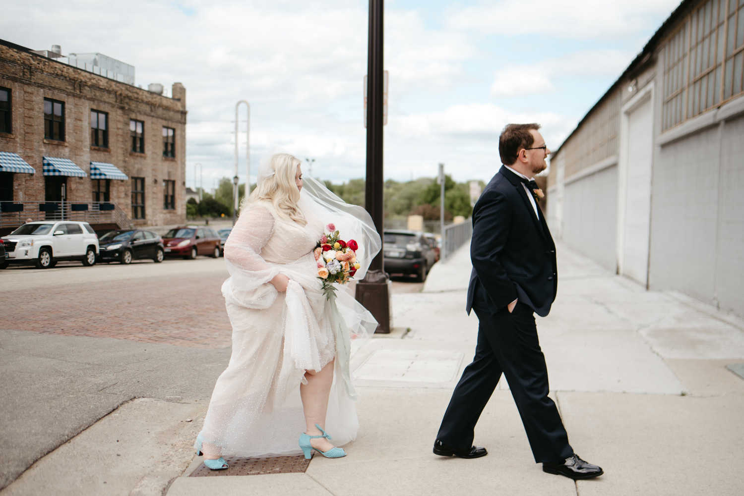 Bride and groom walking across the street in Downtown Minneapolis