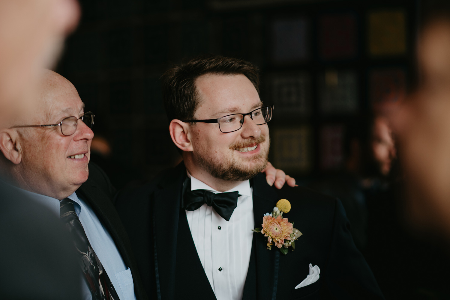 Groom socializing with guests during cocktail hour
