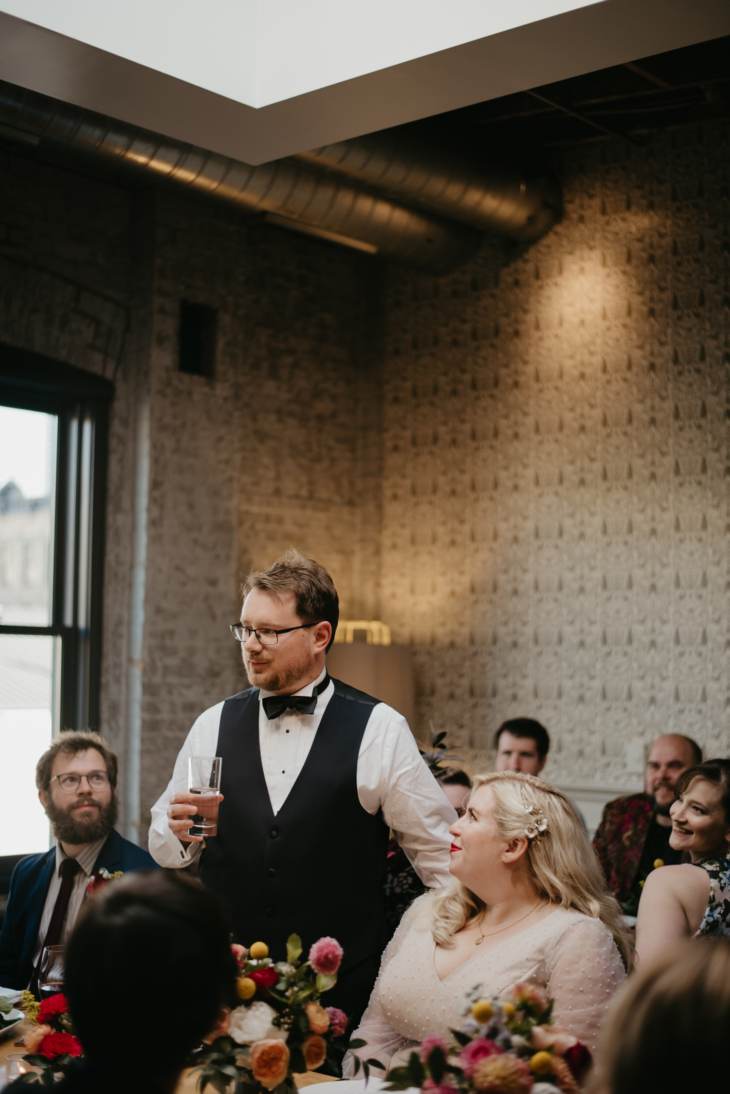 Groom giving a toast during wedding dinner at Bachelor Farmer, Minneapolis