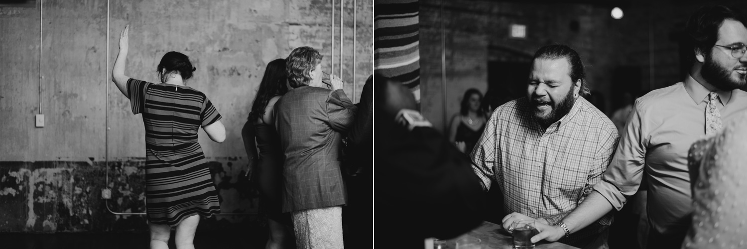 Black and white photo of guests dancing at Bachelor Farmer, Minneapolis during wedding reception