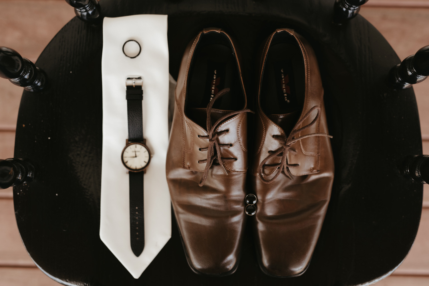 Groom's wedding details including shoes, tie, watch, cufflinks and ring