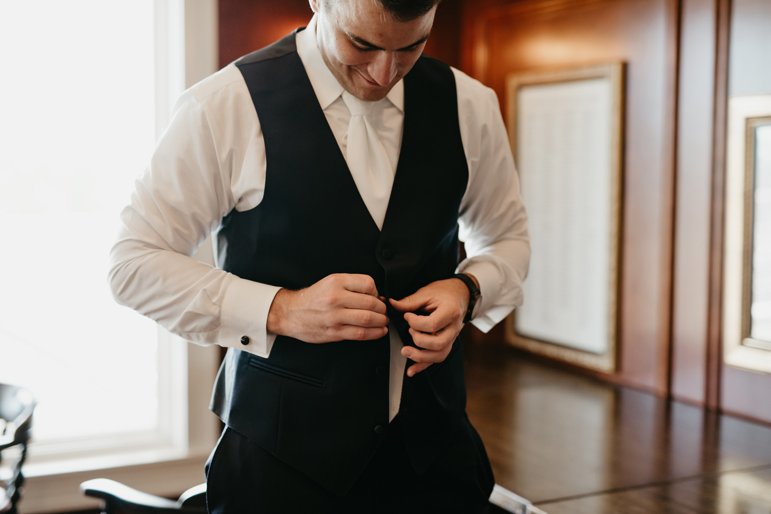 Groom getting ready during wedding day