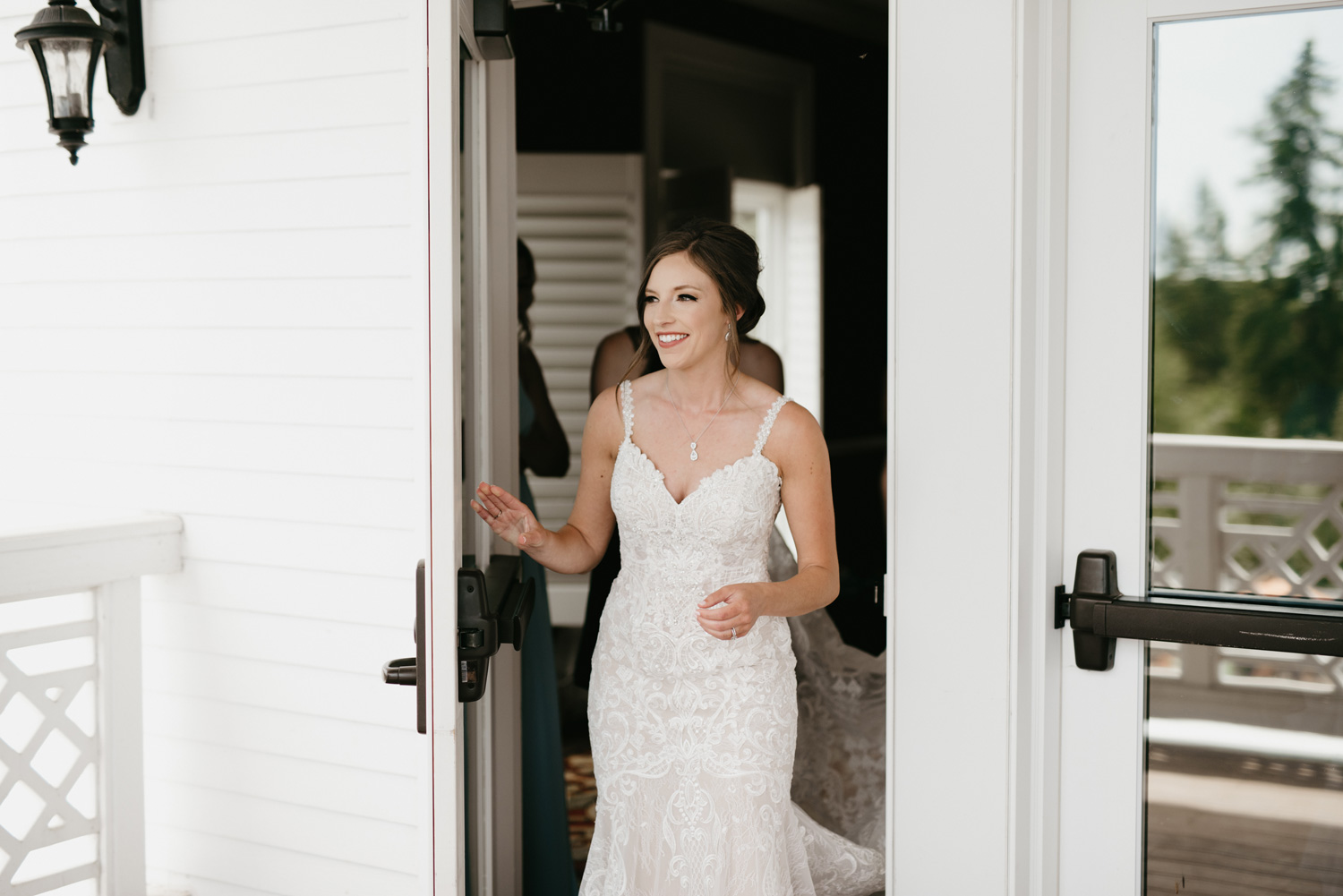 Bride coming out of doors for first look
