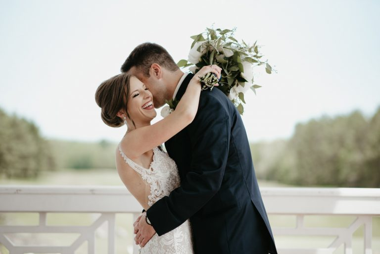 Bride and groom laughing pictures outdoors