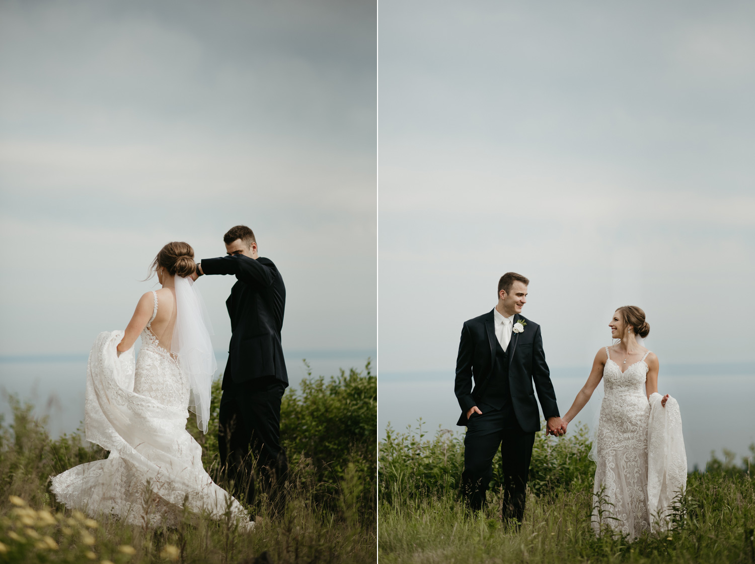 Bride and groom standing in a field overlooking the lake