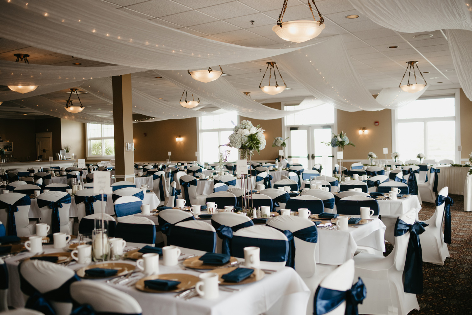 Navy blue and white wedding reception room