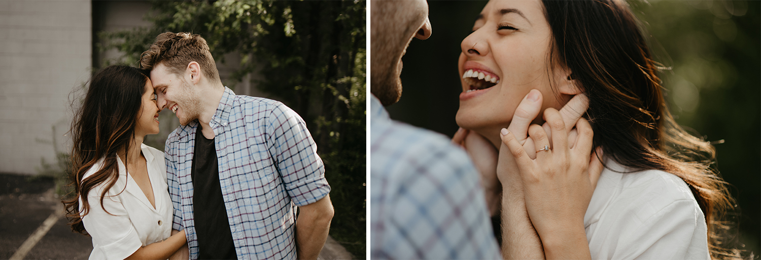 Man and woman laughing during engagement photos in urban environment