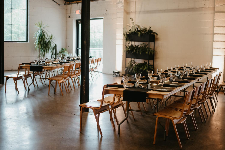 Black plate place setting tablescape decor Paikka MPLS St Paul