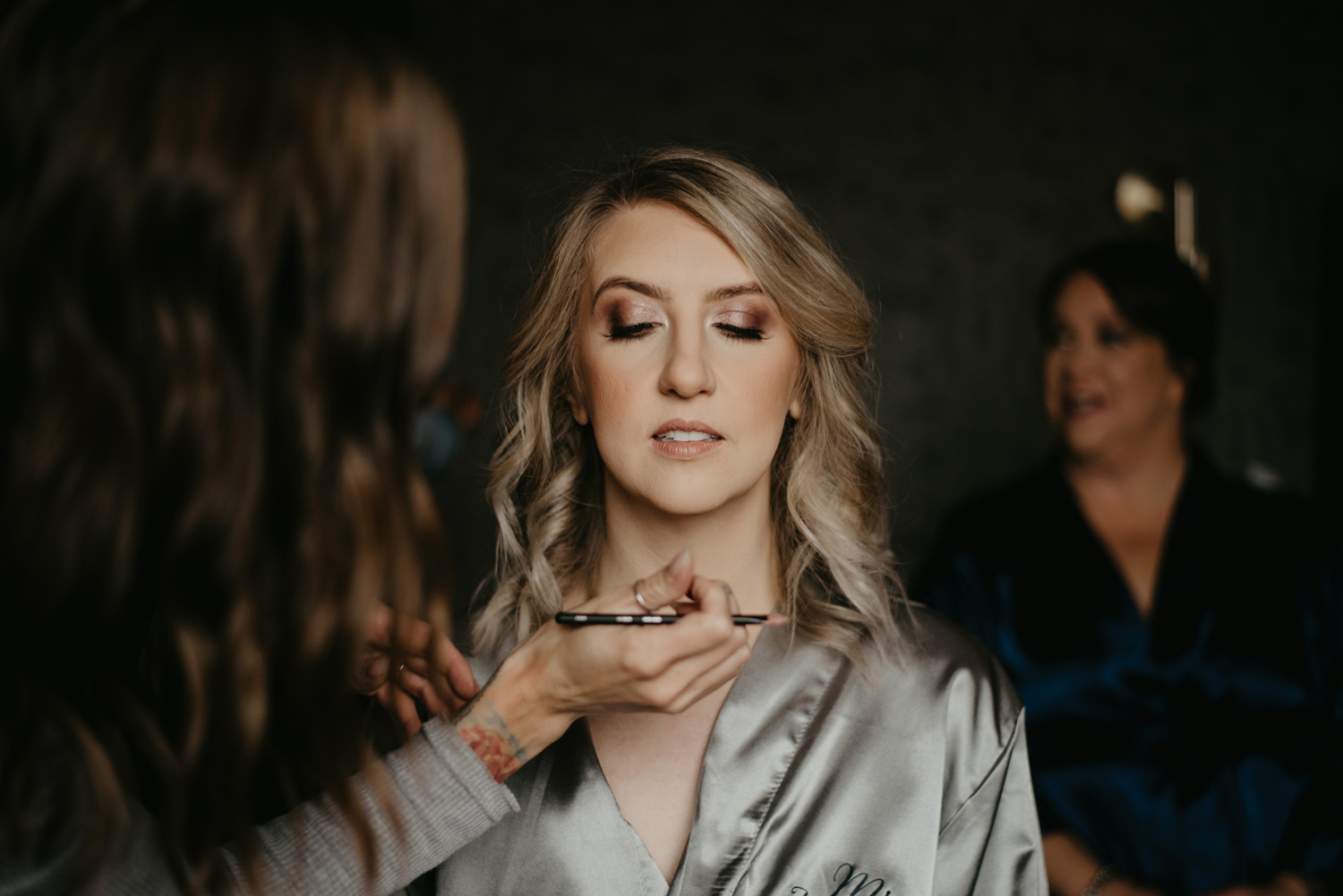 Bride getting makeup done at Hewing Hotel Minneapolis