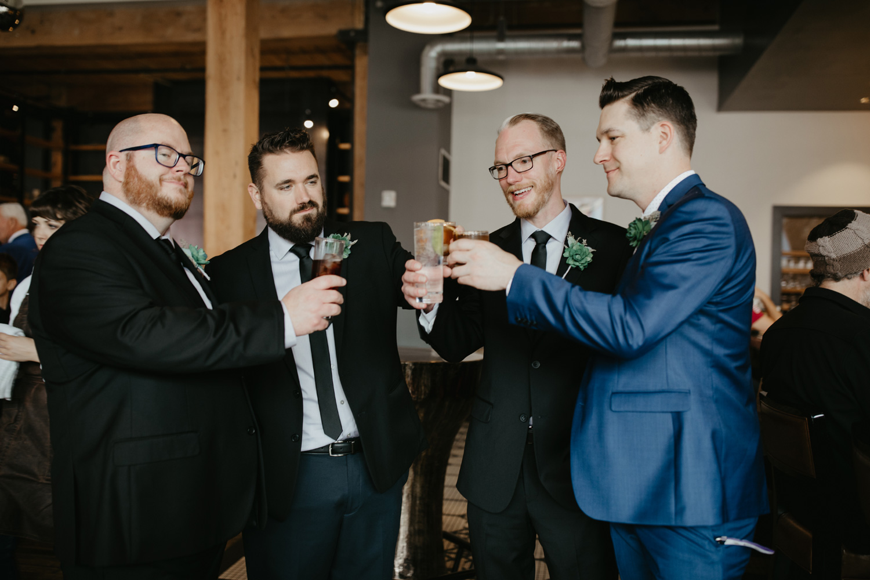 Groom toasting with groomsmen at Hewing Hotel Minneapolis