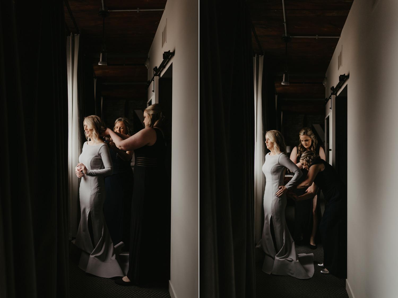 Bride getting into grey wedding sneakers at Hewing Hotel Minneapolis