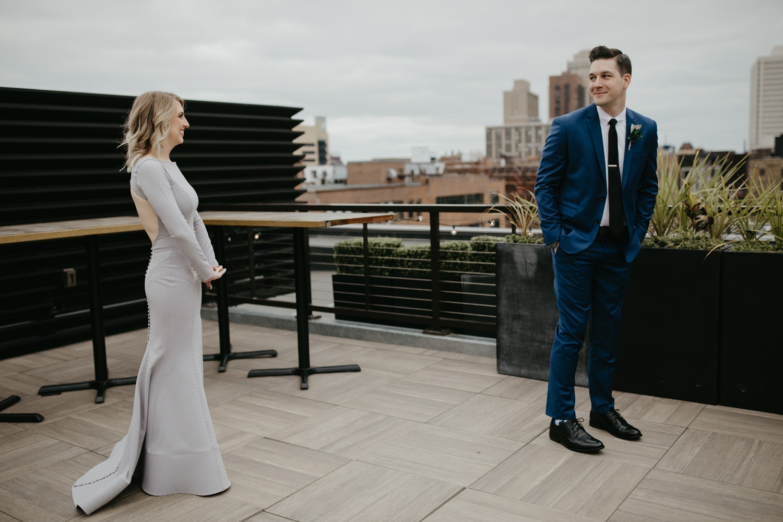 Groom seeing bride first look downtown minneapolis rooftop at Hewing Hotel Minneapolis