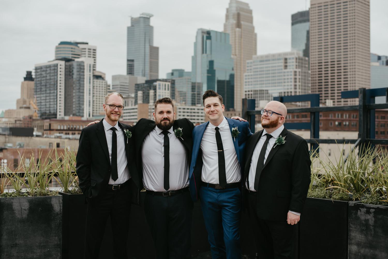 Groomsmen on downtown Minneapolis rooftop Hewing Hotel