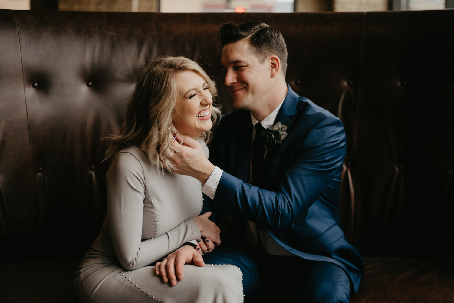 Bride and groom cuddling indoors on couch Hewing Hotel Minneapolis