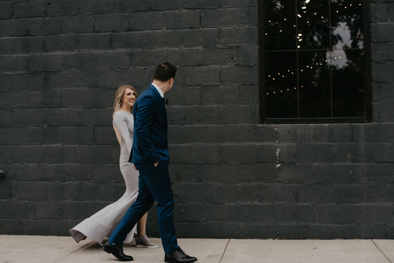 Bride and groom outside of garage door Paikka Minneapolis St Paul
