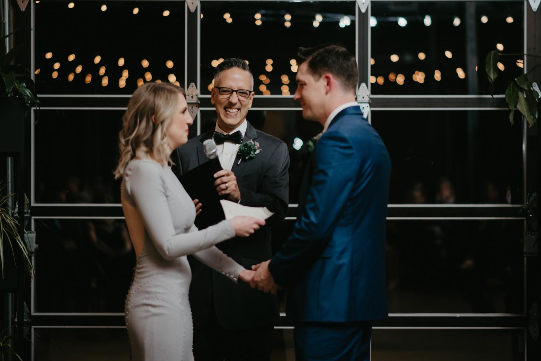 Bride and groom wedding ceremony in front of garage door Paikka Minneapolis St Paul