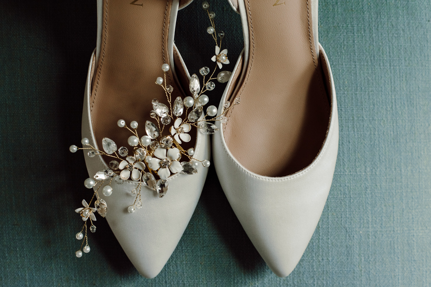 white wedding shoes with hair piece