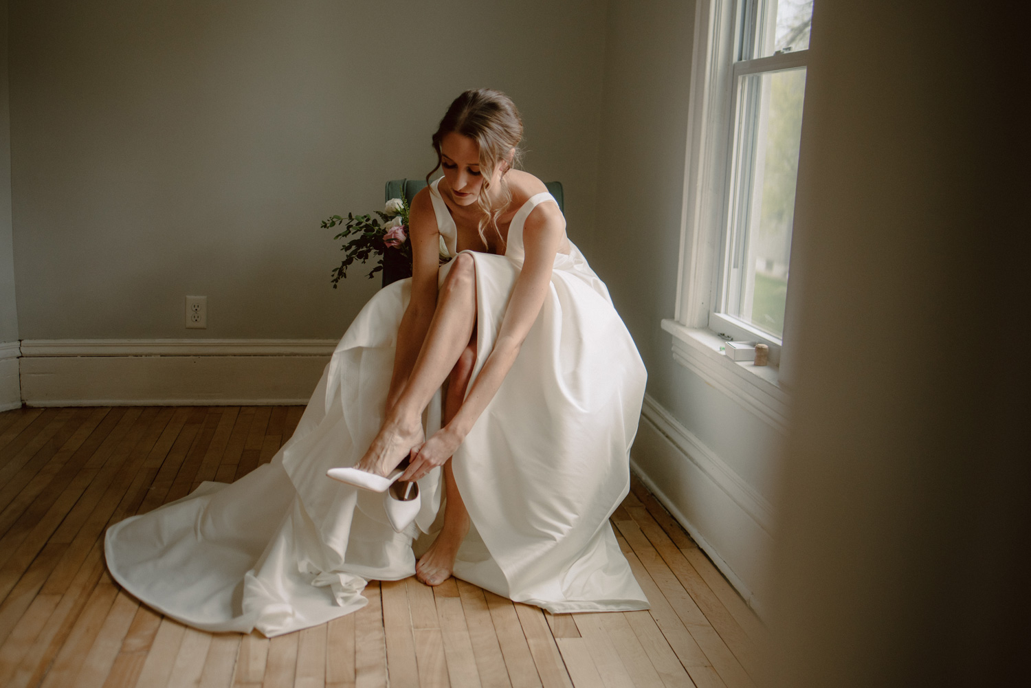 bride putting on shoes covid wedding minneapolis