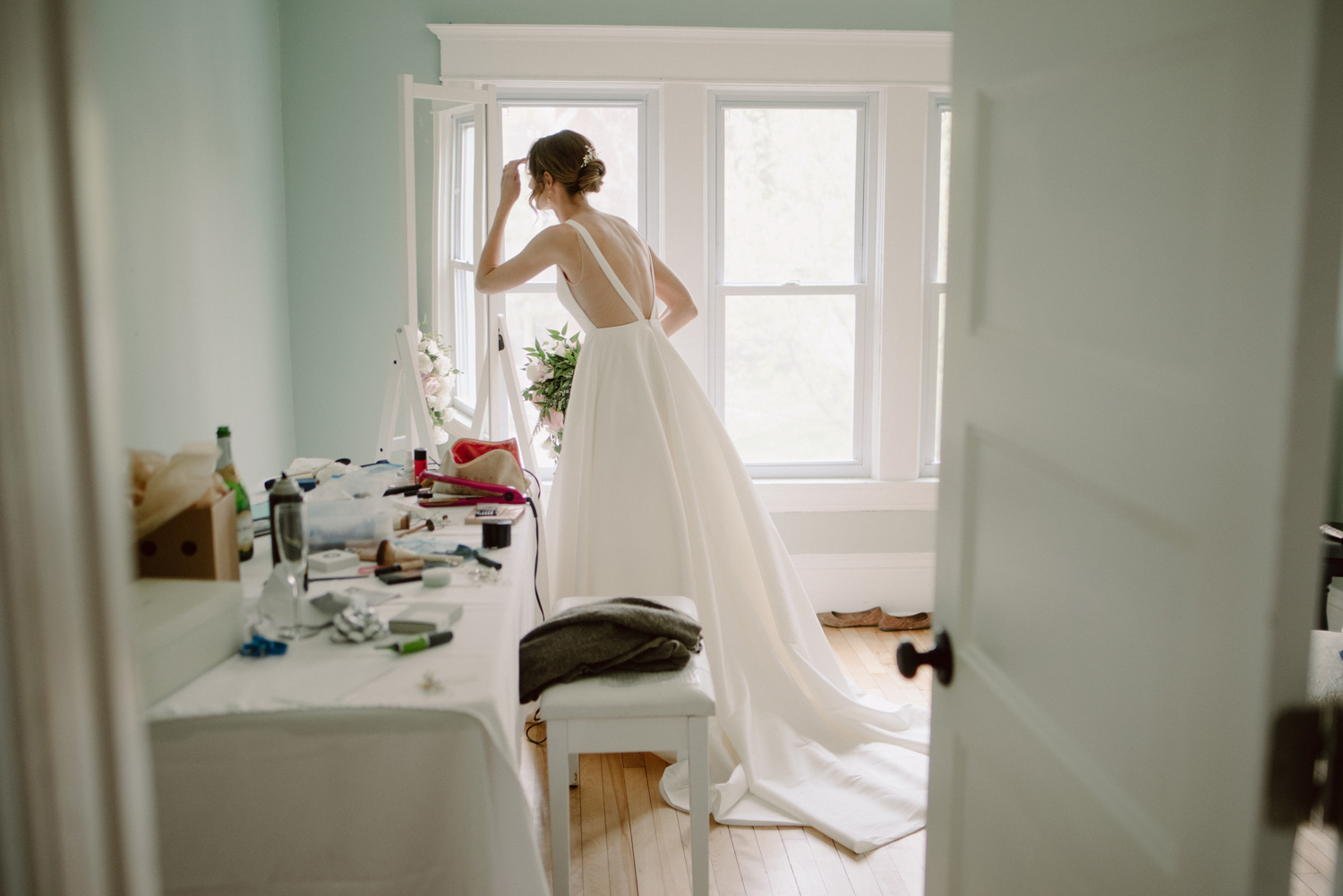 bride fixing her makeup alone in home minneapolis